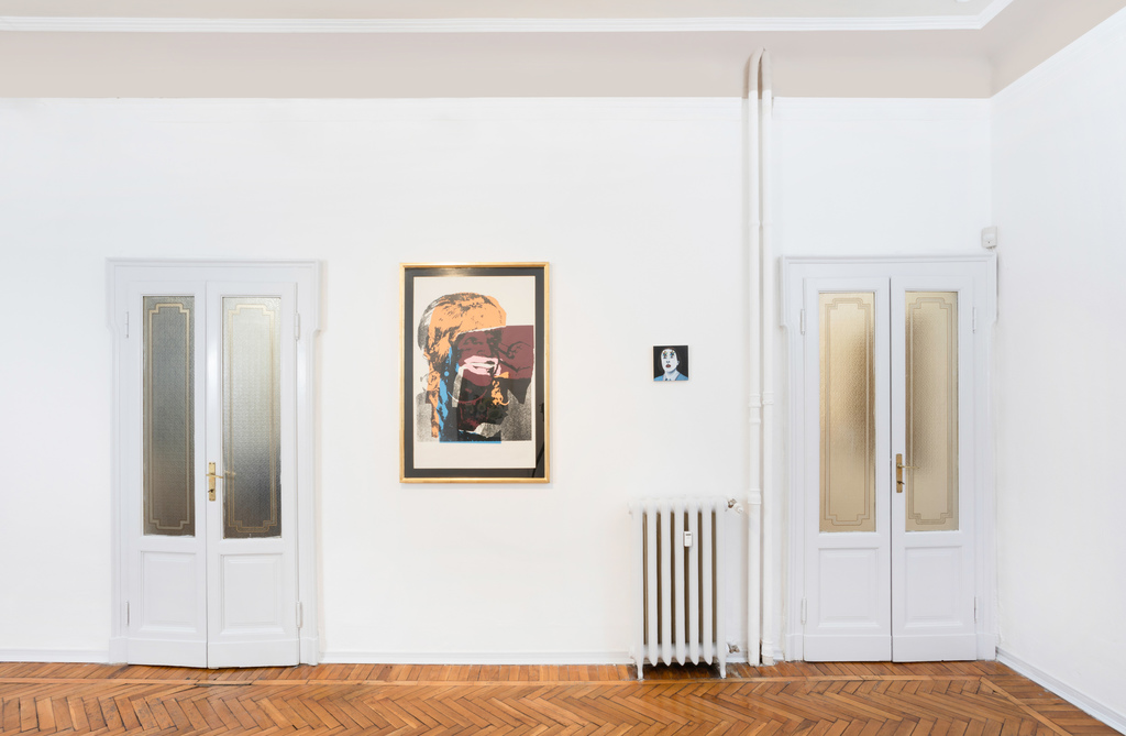 an installation shot of the gallery show: from left to right Andy Warhol, Silvia Idili.
