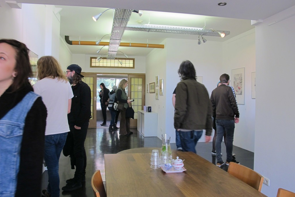 Visitors during Roadburn Festival for the solo exhibition 'Brilliant Shadows' by Arik Roper.