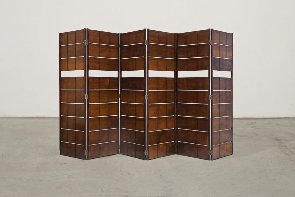 Room divider by Joaquim Tenreiro Brazil, 1950s 6 modules Unique example, designed for a private residence, São Paulo  Provenance: Luisa Strina Gallery Collection, São Paulo Jacarandá wood  360 x h 167 cm 141.7 x h 65.7 in