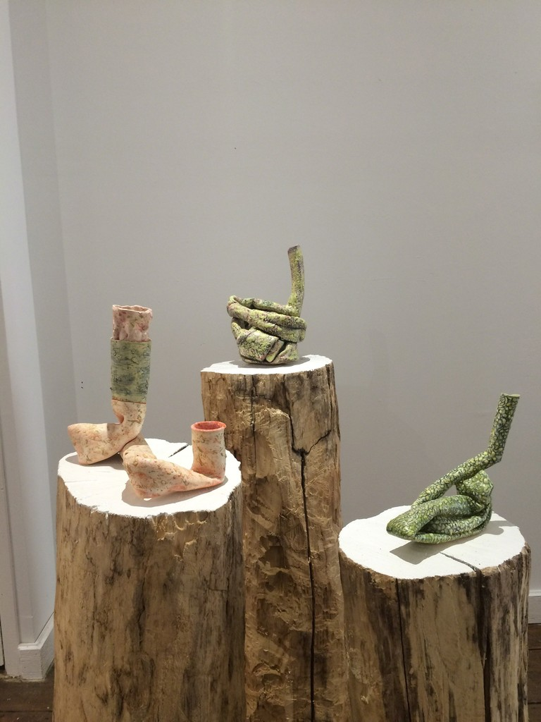 "CERAMICS: A Concept of Function, installation view. Pictured: Elisa D'Arrigo, ""Twisted 6,"" ""Twisted 8,"" ""Orange Sprawl."""