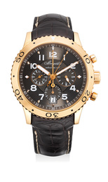A fine and attractive pink gold flyback chronograph wristwatch with 24 hours indication, date, guarantee and box
