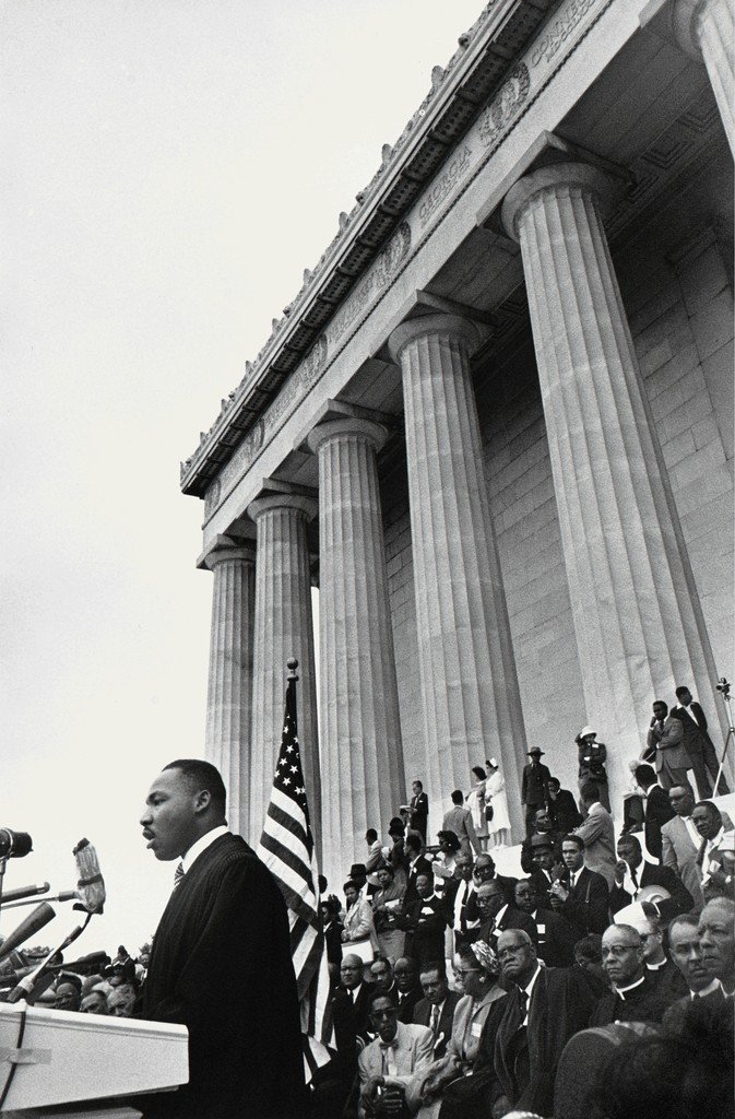 Lee Friedlander, Reverend Martin Luther King, Jr. (at podium); first row: Bishop Sherman Lawrence Greene, Bishop William Jacob Walls, Roy Wilkins, and A. Philip Randolph, from the series Prayer Pilgrimage for Freedom, 1957, printed later. Gelatin silver print. Yale University Art Gallery, Gift of Maria and Lee Friedlander, Hon. 2004. © Lee Friedlander, courtesy Fraenkel Gallery, San Francisco. Photo courtesy Eakins Press Foundation