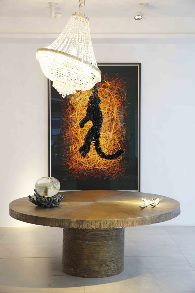 Michele Oka Doner has been creating works in bronze, wood, and natural materials for the last 50 years: her table Radiant is here seen below contemporary artist Barnaby Barford's light sculpture 'Jungle VIP' which he first created in 2014 for a special exhibition at the gallery entitled 'Chandeliers.'