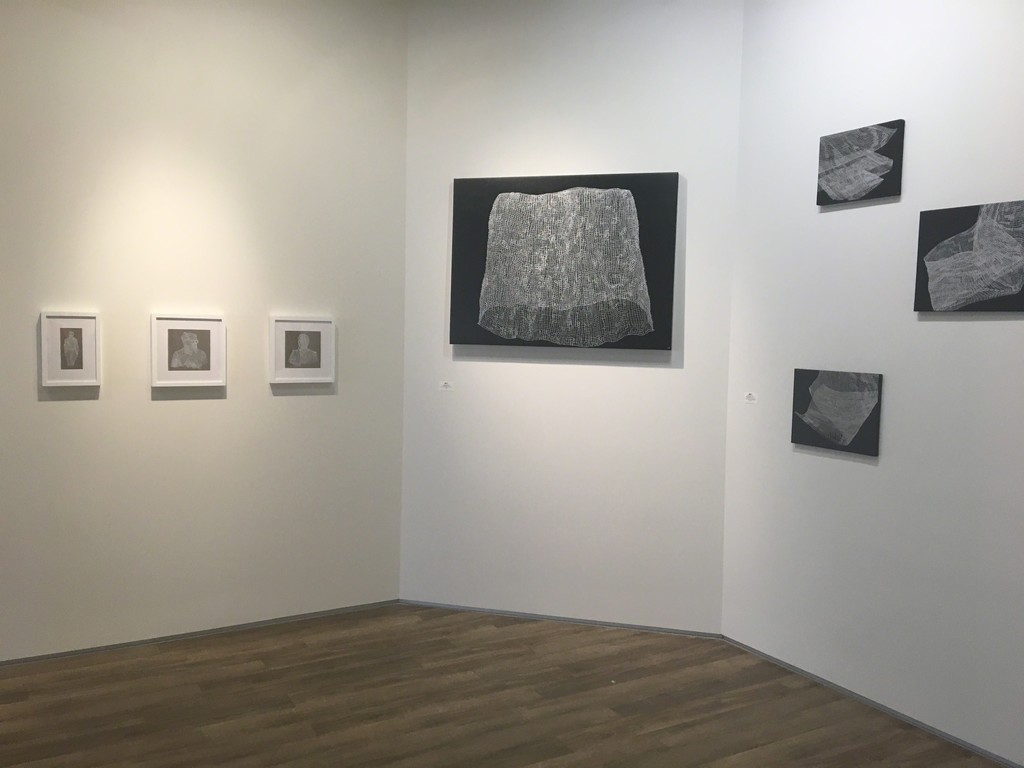 Works by Sarah McCoubrey on left; right: silver ink drawings on black painted canvas by Caroline Burton.