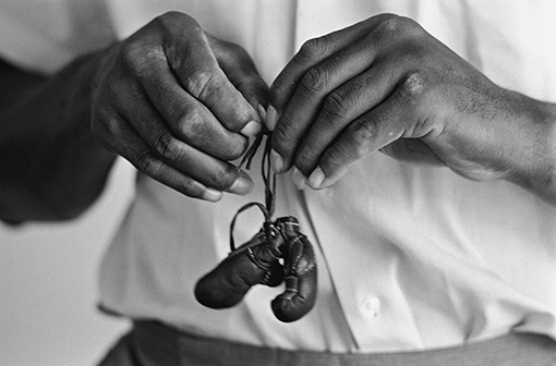 , 'Muhammad Ali with Mini Gloves,' 1963, CAMERA WORK