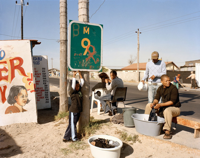 , 'At Kevin Kwanele's Takwaito Barber, Lansdowne Road. Khayelitsha, Cape Town, in the time of AIDS,' 2007, Goodman Gallery