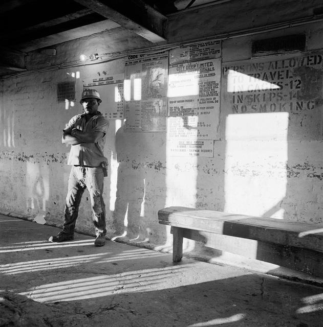 David Goldblatt, 'A miner waits on the bank to go underground, City Deep Gold Mine', 1966, Goodman Gallery