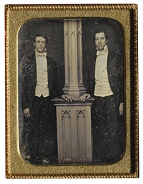 Well-Dressed Men Posed by Column