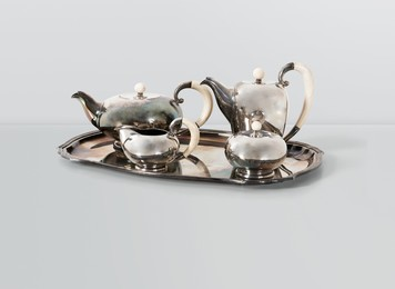 a silver tea set made up by a teapot, a coffee pot, a milk jug and a sugar pot