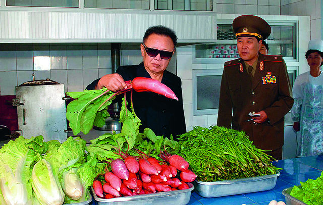, 'Looking at a Radish, from the book Kim Jong Il Looking at Things,' 2012, Museum of Contemporary Photography (MoCP)
