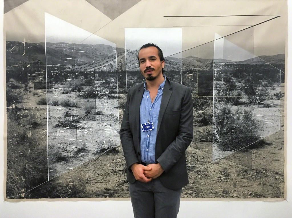 Artist Rodrigo Valenzuela with his work, Sense of Place No. 32.