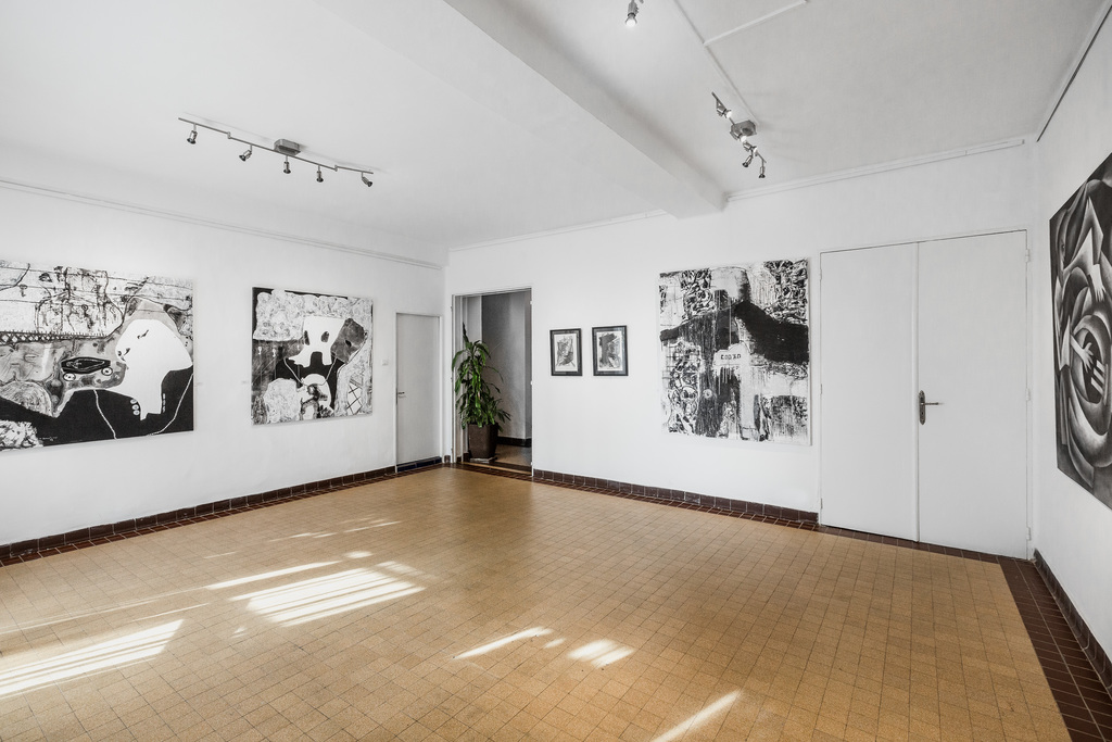 """View from """"Noirs"""" Works by Sambou Diouf (left) and Malick Ceesay (right)."""