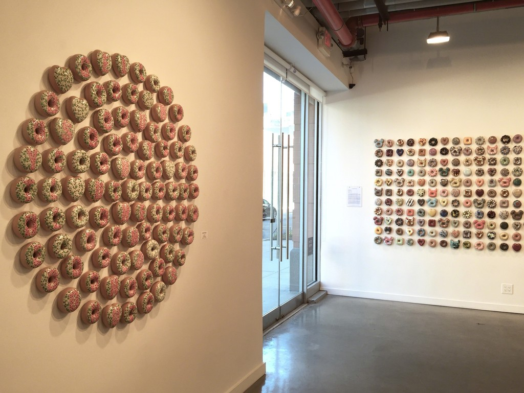 """Buy, Sell, Hold The Donut"" (left) and ""Donut Ever Forget Me"" installation (right)"