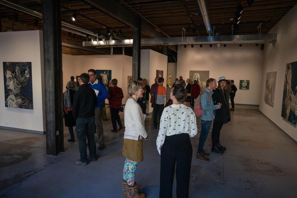 "View of opening reception of Sirpa Särkijärvi ""Transcriptions"" - artist in conversation in the foreground."