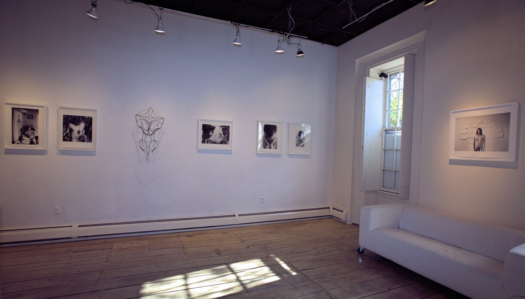 "Installation view from  360 MOONS , to the right- ""Kinsmen-Self portrait, 1996"""