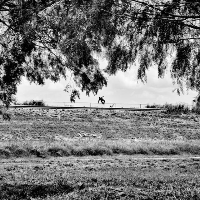 , 'Jumping the border fence. McAllen, TX. ,' 2015, Anastasia Photo