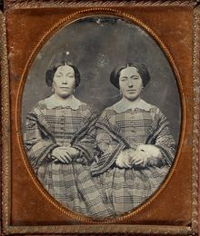 Group of two daguerreotypes of female twins
