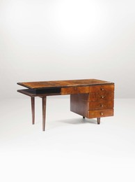 A desk with a wooden structure and brass details