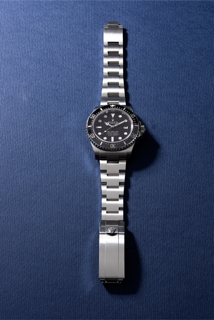 Rolex, 'A fine stainless steel diver's wristwatch with date, center seconds, gas escape valve, bracelet, guarantee, hang tag and presentation box', Circa 2015, Phillips