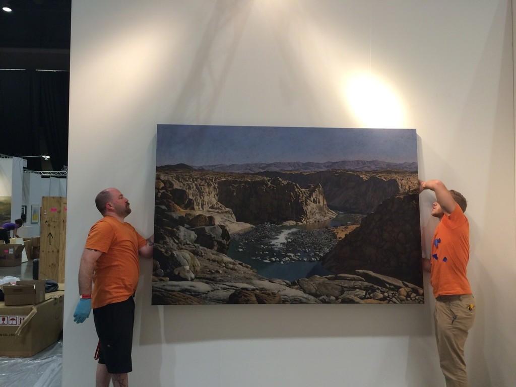 Artech boys installing John Meyer painting.
