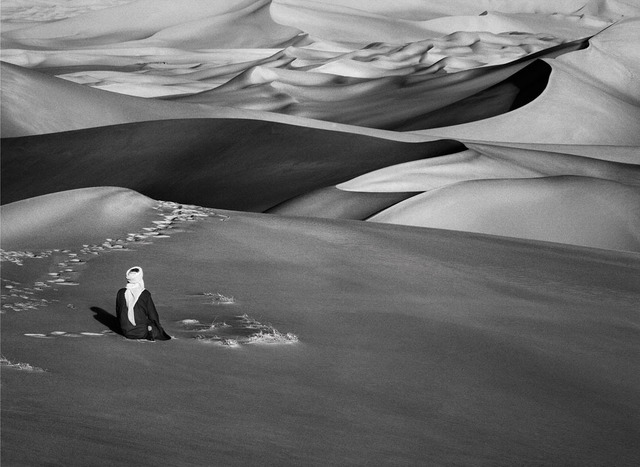 , 'Man praying in the sand dunes in Maor, Tadrart, South of Djanet, Algeria,' 2009, Sundaram Tagore Gallery