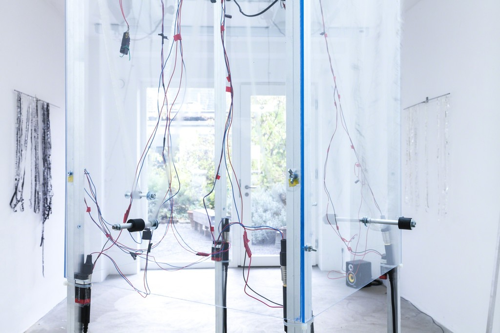"Jens Standke, exhibition view: ""Transparent Tape Machine"", 2016, detail, Jens Standke   d.i.y.-audio band machine for transparent tape: laser, electronics, motor, aluminium, acrylic glas   image: ©dasesszimmer"