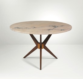 A low table with a wooden structure and marble top