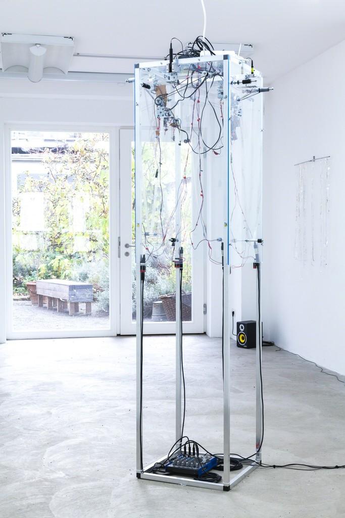 "Jens Standke, exhibition view: ""Transparent Tape Machine"", 2016   d.i.y.-audio band machine for transparent tape: laser, electronics, motor, aluminium, acrylic glas   image: ©dasesszimmer"