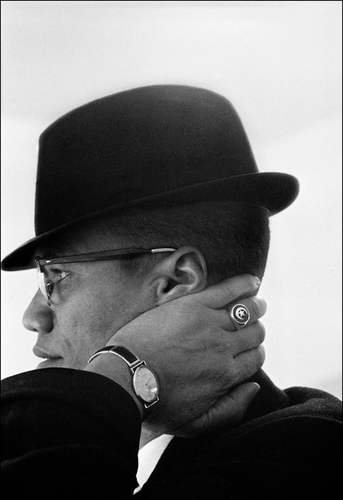Malcom X during his visit to enterprises owned by Black Muslims. Chicago,