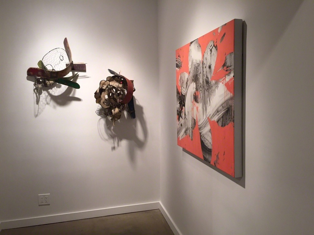 "Duane Paul sculptures (left) and Jeff Muhs ""Raptuous,"" Oil and mixed media on canvas (right)"