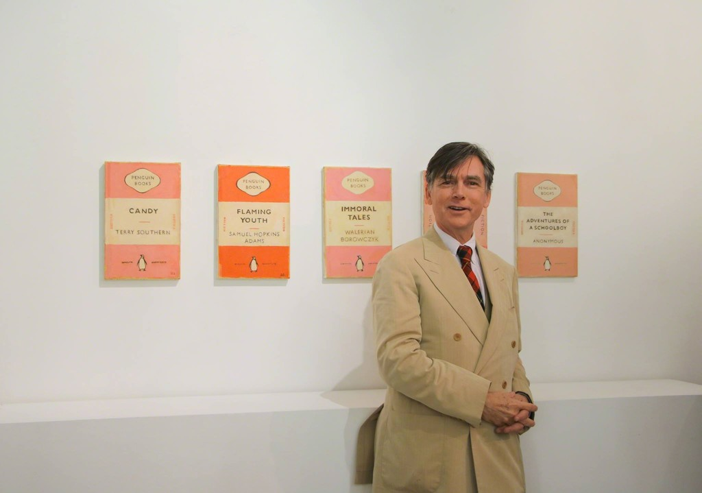 Duncan Hannah in front of his Penguin Books paintings