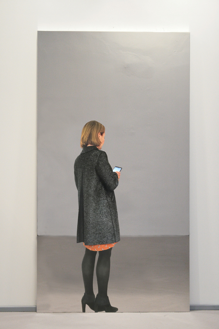 , 'Woman with coat and smartphone,' 2018, Luhring Augustine