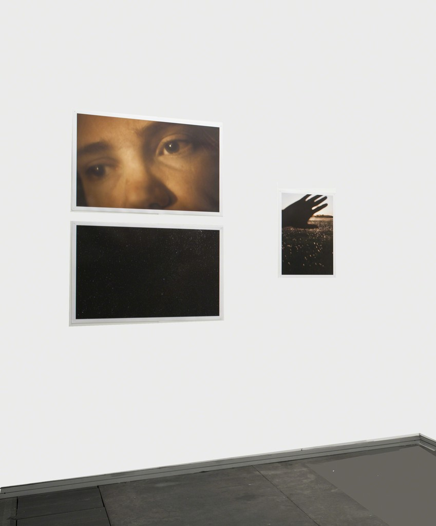 Booth View. Ignacio Iasparra with photographs of the series Transparency Impossible To Floating Bliss