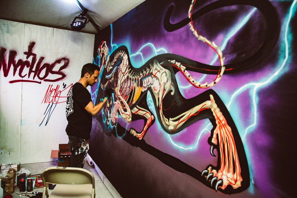 "Nychos live painting ""Dissection of Black Panther"". Limited edition prints will be released after the festival."