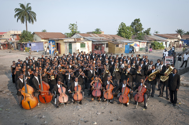 , 'The Kimbanguist Symphony Orchestra in a street of Ngiri Ngiri in Kinshasa,' 2009, Louisiana Museum of Modern Art