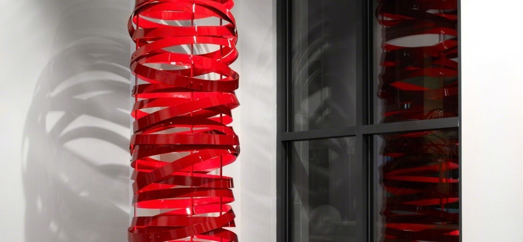 Gordon Huether / Red Barrel Ring, Recycled Materials, Lighting and Paint, 2' DIA x 8'H, 2010