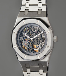 A very fine and rare stainless steel skeletonized wristwatch with original guarantee, presentation box, and accessories