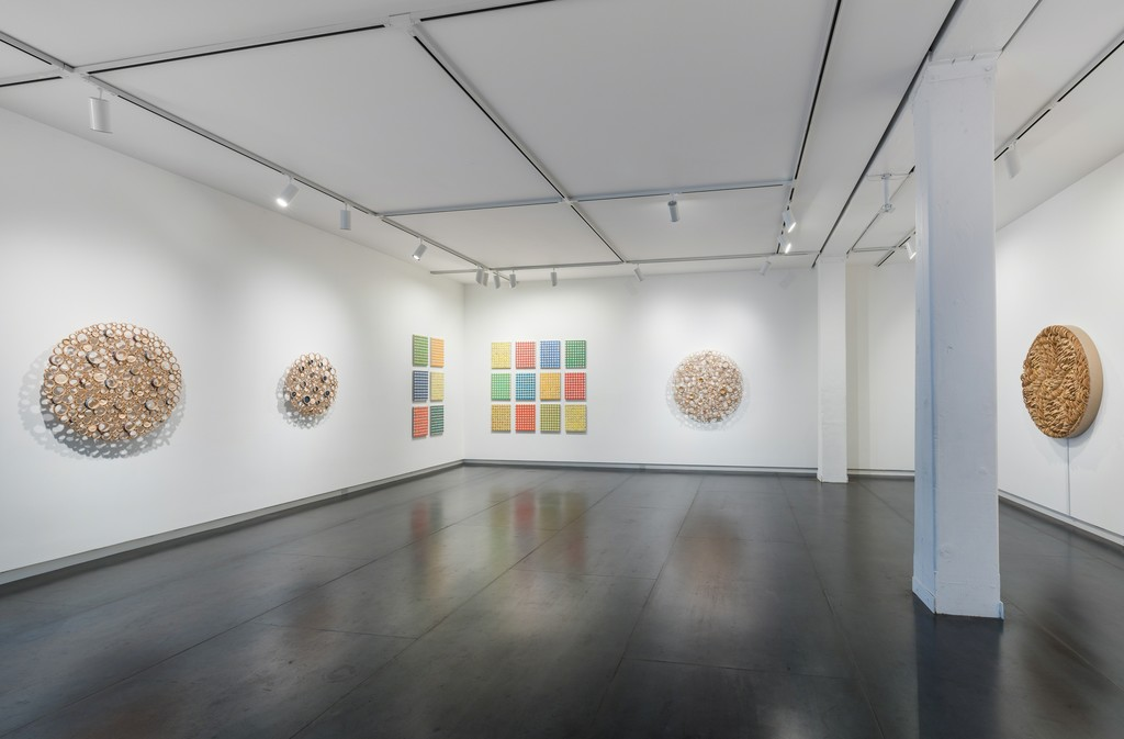 Gingham paintings by Michelle Grabner, bamboo sculptures by Anne Crumpacker. Photo by Mario Gallucci.