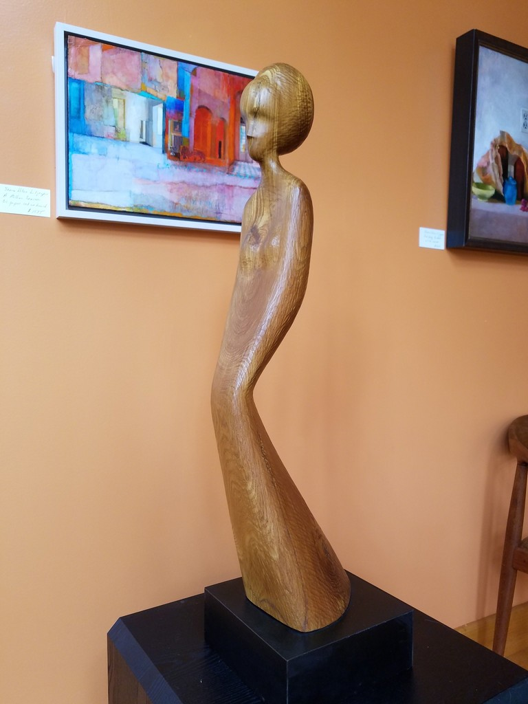 Hostetler chestnut sculpture, Quiet Woman and Sherre Wilson Liljegren's A Million Reasons