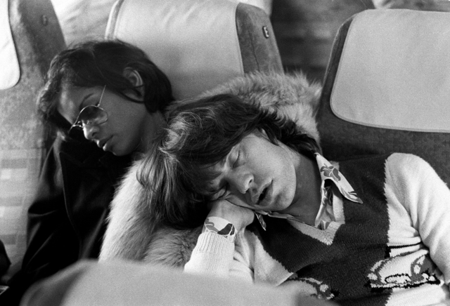 , 'Mick Jagger and Bianca Jagger asleep on the morning flight after The Rolling Stones 'End of Tour Party', Berlin,' 1973, ElliottHalls