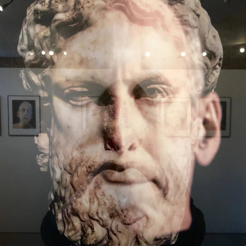 Deity (Zeus). David Weinberg superimposes self-portraits onto images ranging from mythological figures to animals to X-rays and everything in between. His reflection is one of identification with these icons, as he attempts to define his own persona.