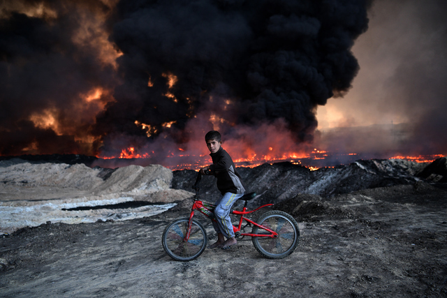 , 'Boy and Burning Oil Field,' 2016, Getty Images Gallery