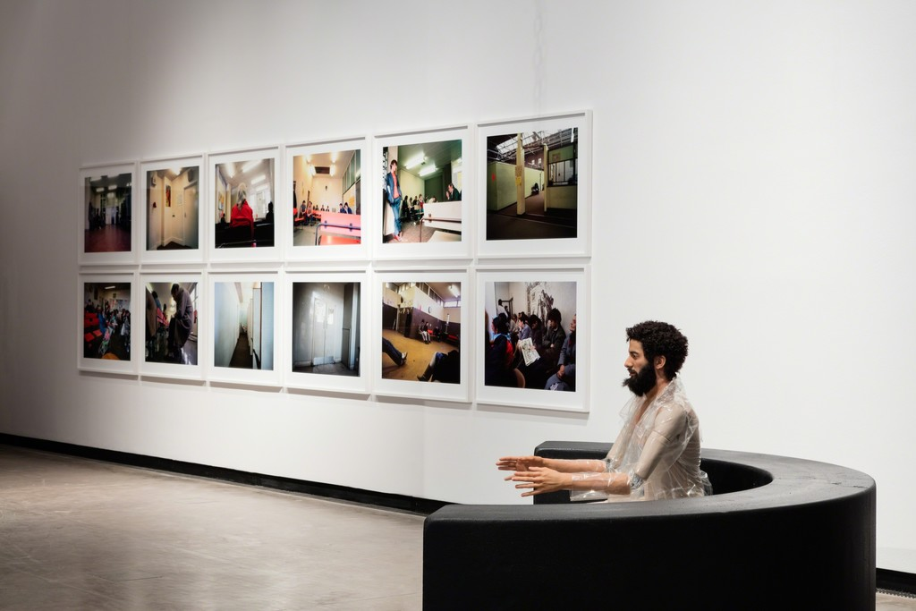 Installation view: How To Live Together, Kunsthalle Wien 2017, Photo: Stephan Wyckoff: Paul Graham, Beyond Caring, 1984/85, © Paul Graham, Courtesy Anthony Reynolds Gallery, London; Goshka Macuga, To the Son of Man Who Ate the Scroll, 2016, Courtesy Fondazione Prada, Milan