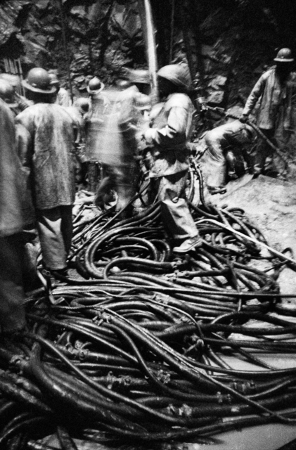 David Goldblatt, 'Shaftsinking: air and water hoses have been lowered to the bottom and are being connected to drill the blast holes. President Steyn No. 4 Shaft, Welkom, Orange Free State', 1970, Goodman Gallery
