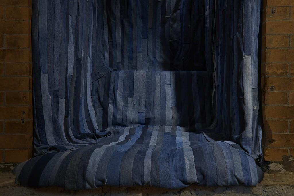 Carey Denniston, 2018, detail, SculptureCenter, New York, 2018. Three videos on iPads, denim, plywood, foam, lights, speakers. Videos: 20 minutes, 25 minutes, 25 minutes. Dimensions variable. Courtesy the artist. Photo: Kyle Knodell