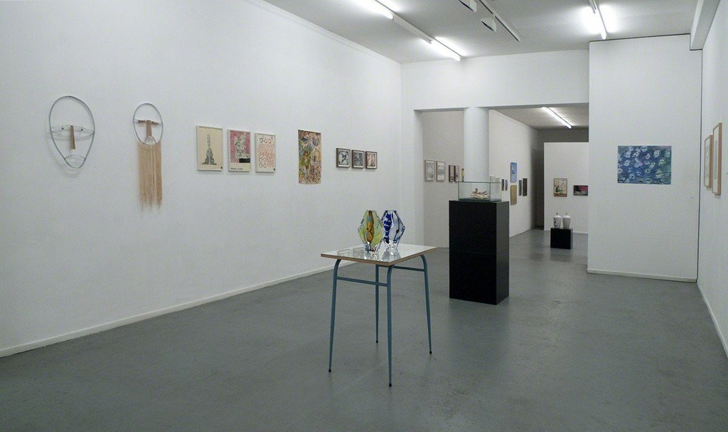 Front room with two glassworks by Christie van der Haak and Zeger Reyers' book prepared with mushrooms.