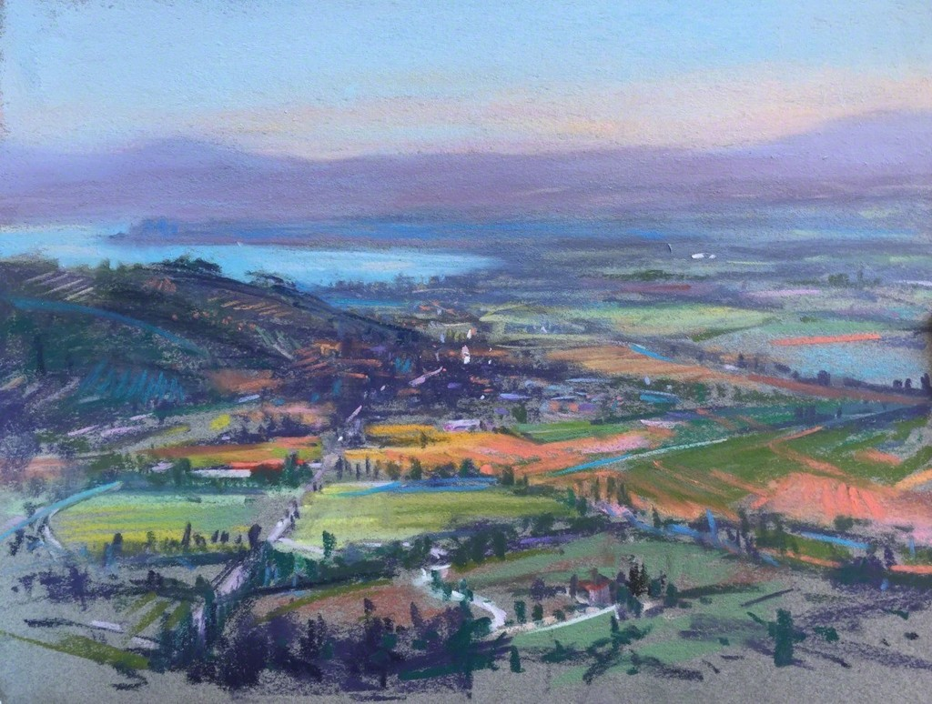"""""""Cortona View,"""" Pastel on paper, 9 x 12 When painting this aerial view of Cortona, Italy, the colors in the landscape were wonderful. Sunflowers, grasses, the water, the greens in the trees, the blues and purples in the shadows."""" - Linda Richichi"""