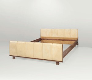 A bed with a wooden structure and parchment lining