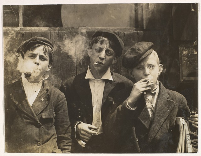 Lewis Wickes Hine, '11:00 A.M. Monday, May 9th, 1910. Newsies at Skeeter's Branch, Jefferson near Franklin. They were all smoking. Location: St. Louis, Missouri.', Mon May 09 00:00:00 EST 1910, The Metropolitan Museum of Art
