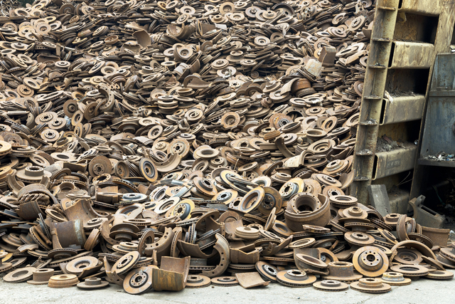 , 'Steel disk brakes, obtained from dismantling discarded cars, going to steel mills for reprocessing into new steel.,' 2015, Anastasia Photo